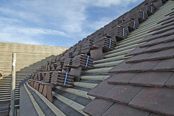 Pitched roofing is the most common form of roofing.  There are a variety of different pitched roof coverings that you can have on your property, though your home will be more suited to certain ones than others.  We can provide or source new or used tiles / slates to match into your existing roof or provide samples for a replacement roof.  We use the best quality breatherable underlays, ridge and eave ventilation system to provide optimal air flow and eliminate condensation.